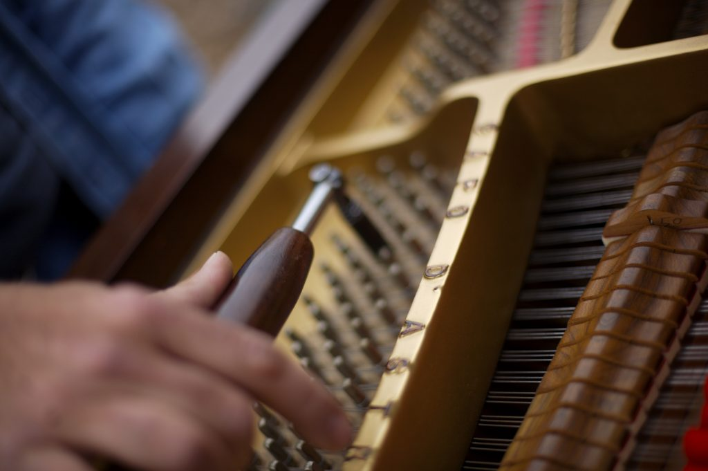 Piano tuner doing his thing